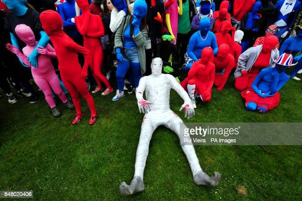 Some of the 145 people wearing Morphsuits at Drayton Manor Theme Park Tamworth where they gathered to beat last years figure 112 people gathered in...