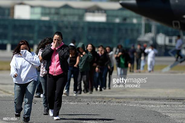Some of the 243 immigrants deported from the United States arrive at the Air Force base in Guatemala City on January 2 2014 The US deported 50221...