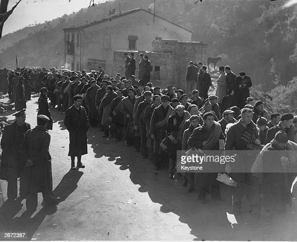 Some of the 3000 members of the International Brigade consisting of Poles Czechs and Germans entering the border town of Le Perthus with the...