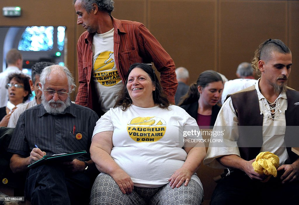 Some of the 60 anti-Genetically Modified Organisms (GMO) militants, accused of destroying MGO plants, wait for the start of their trial at Colmar courthouse on September 28, 2011, eastern France.