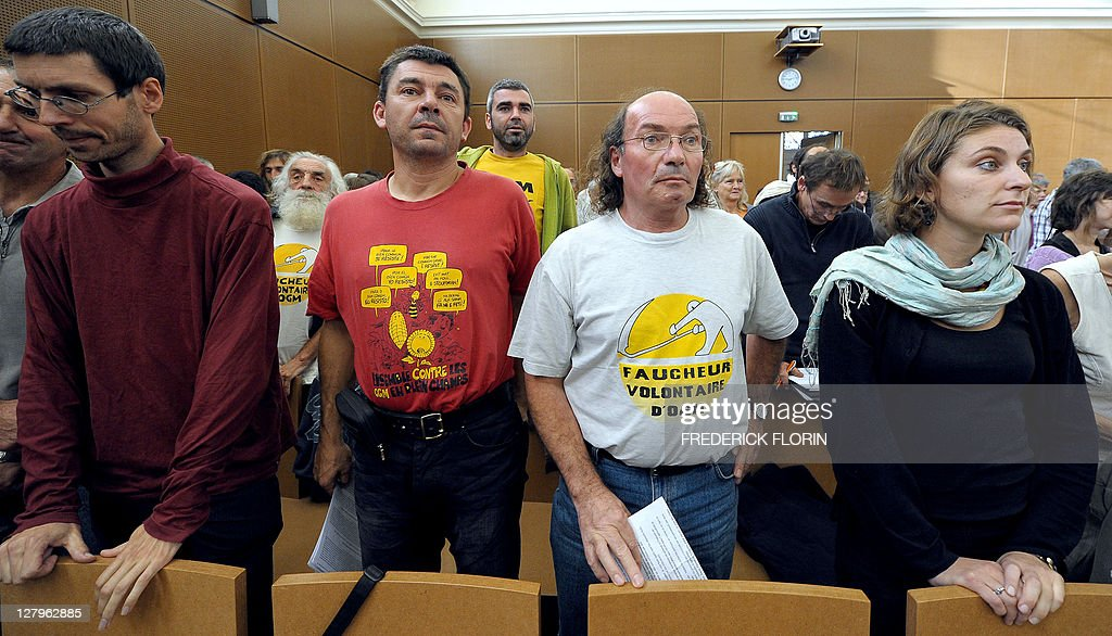Some of the 60 anti-Genetically Modified Organisms (GMO) militants, accused of destroying MGO plants, wait for the start of their trial at Colmar courthouse on September 28, 2011, eastern France. AFP PHOTO/FREDERICK FLORIN