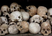 Some of the 8000 human skulls sit in a glass case at the Choeung Ek Genocidal Center where July 26 2010 in Phnom Penh province Today the UN backed...