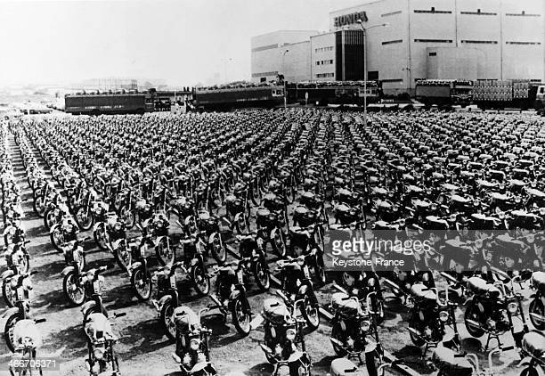 Some of the 880000 motorcycles produced in the last 10 months by the Honda factory in Suzuka are lined up outside ready for shipping overseas in a...