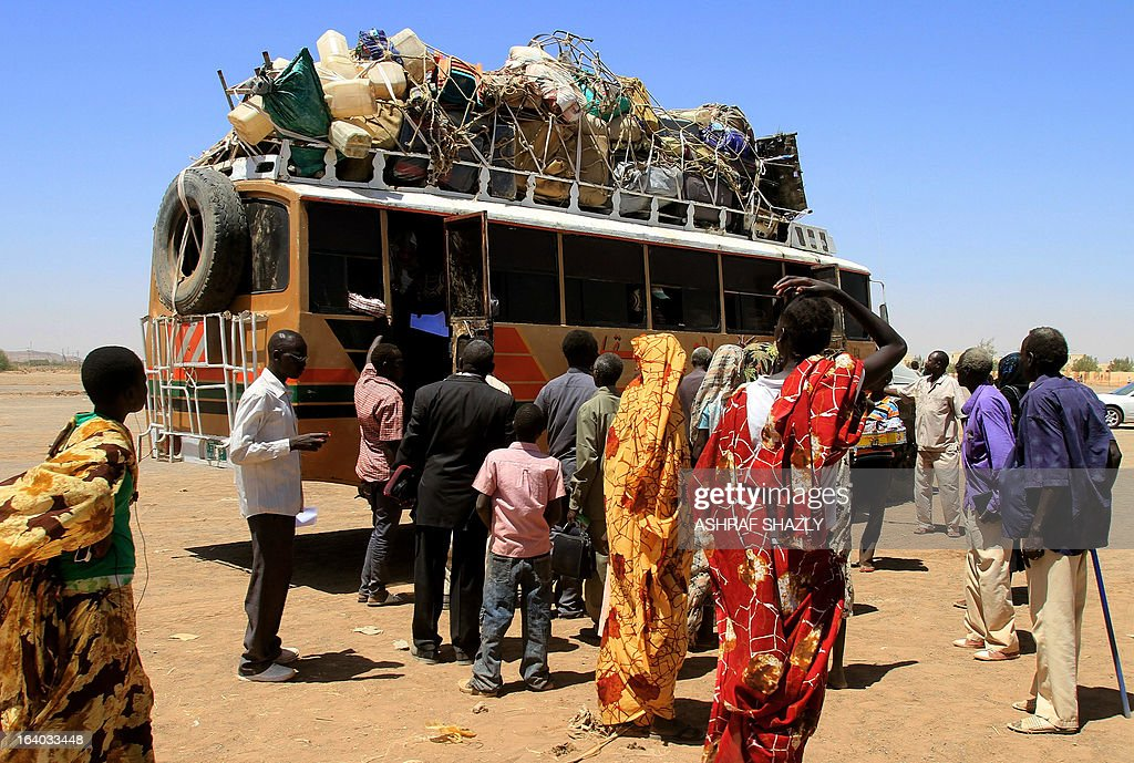 Some of the almost 1000 South Sudanese wait to leave the Sudanese capital Khartoum on one of 40 buses on March 19, 2013. South Sudan's embassy and the Africa Inland Church arranged the convoy to Malakal, in South Sudan's Upper Nile state, after Sudanese authorities asked them to leave their camp around the Shajara train station in south Khartoum, said Kau Nak, the embassy's deputy head of mission.