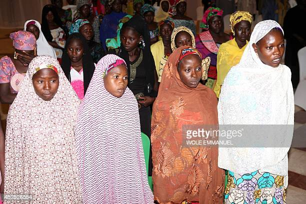 Some of the Chibok schoolgirls who escaped their Boko Haram Islamist captors wait to meet the Nigerian president at the presidency in Abuja on July...