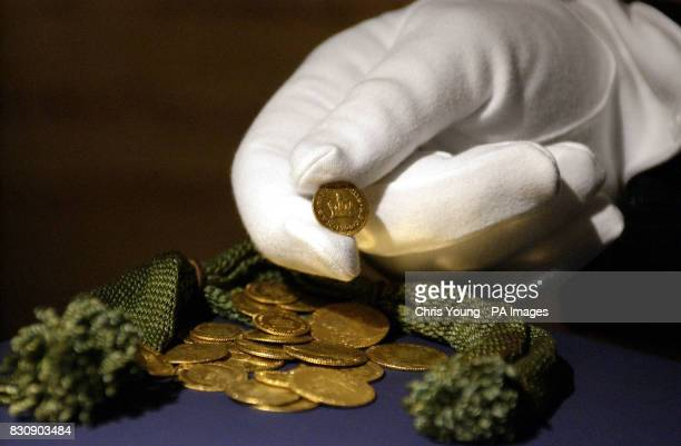 Some of the coins from the bloodstained silk purse Nelson carried on him at the fateful Battle of Trafalgar in 1805 that form part of a collection...