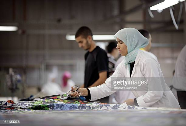 Some of the employees on the factory floor at the textiles production company Sathya Clothiers which supplies clothing to companies such as Desigual...
