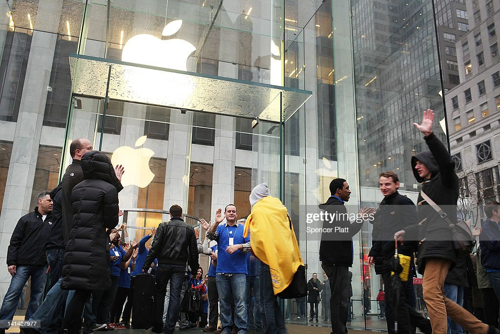 Some of the first customers for the new iPad enter the flagship Apple Store as the tablet went on sale around the world March 16, 2012 in New York City. Simply called the iPad, the new tablet replaces the iPad 2 and features a high-pixel-count 'retina display.' Hundreds of people waited in line all night to be the first into the flagship Apple Store on Manhattan's Fifth Avenue.