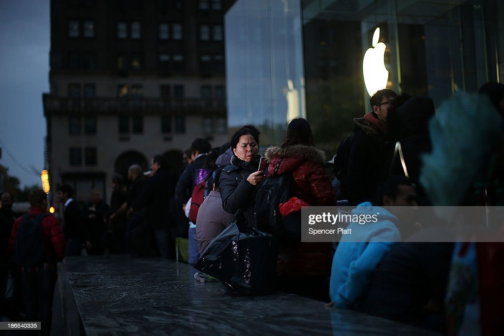 Some of the first customers wait in line at the Apple store to purchase the new iPad Air, the fifth generation of its tablet on November 1, 2013 in New York City. The new iPad, which will also come in a mini version, is 20% thinner and 28% lighter than the current fourth-generation iPad. It has the same 9.7-inch screen as previous iPads and uses the same A7 processing chip that's in the iPhone 5S. The iPad Air, which went on sale today, will start at $499 for a 16GB Wi-Fi-only model and go up to $629 for a 16GB with 4G LTE connectivity.