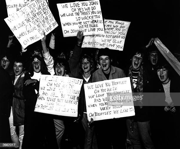 Some of the hundreds of Beatles fans who welcomed the band home after their tour of the United States