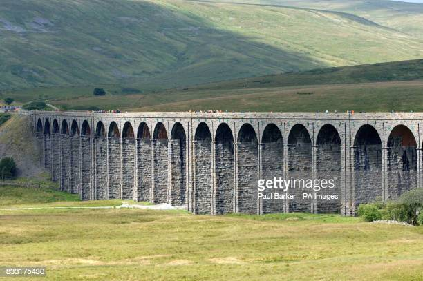 Some of the hundred's of people make the most of today's once in a life time opportunity to walk across the Ribblehead Viaduct on the Carlisle to...