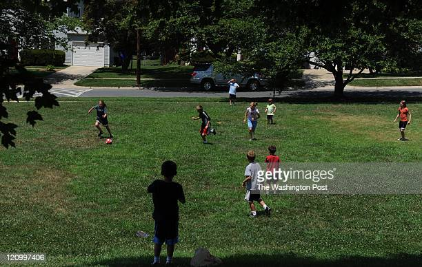 Some of the Kilmer sibling play soccer near their home on August 1 in Rockville MD Jen and Larry Kilmer are raising 11 children ages 12 to 1 None of...