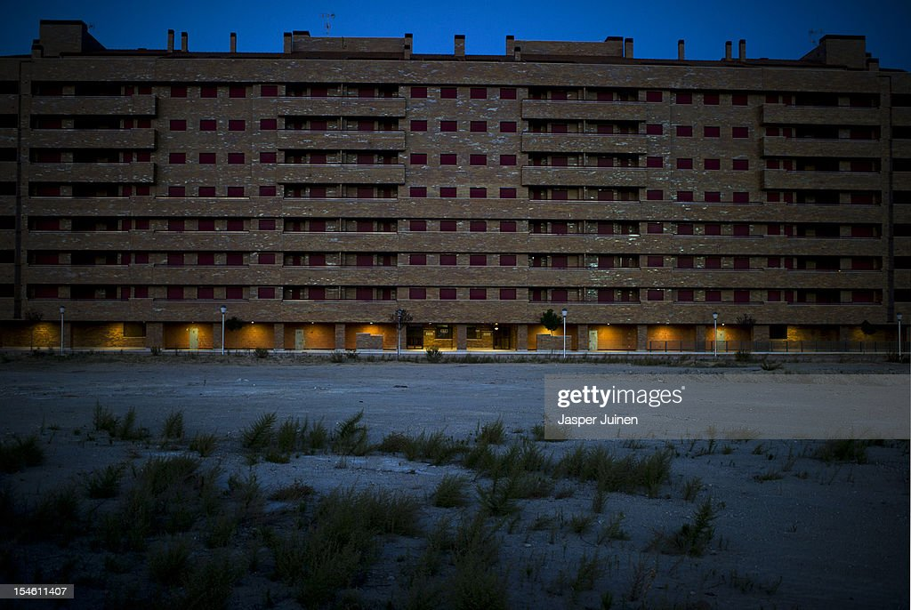 Some of the many empty newly built apartment buildings stand with their exterior window shutters closed on October 22, 2012 in Sesena, Spain. With a housing backlog of more than 1.2 million unsold newly build homes, banks in Spain have recenlty started to sell their real estate assets with discounts, some upto 80 percent, slashing prices to a level not seen for over 20 years. With morgages of 100 percent, some experts worry that mistakes from the past are repeated again.