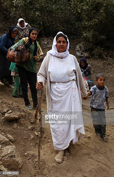 Some of the many thousands of Yezidis who started to flee from Mount Sinjar in northern Iraq and Zakho city to the surrounding mountains across the...