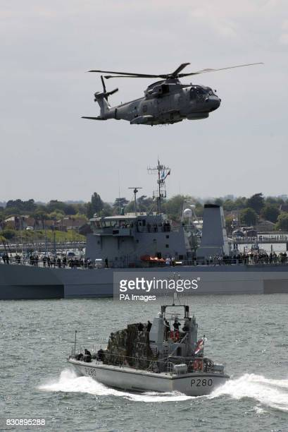 Some of the military equipment and service personnel that Britain's Queen Elizabeth II saw from the aircraft carrier HMS Ark Royal when she watched a...