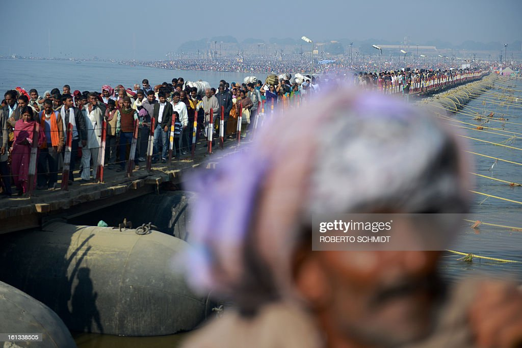Some of the millions of Hindu devotees who have come to take a 'holy dip' in the Sangam, the confluence of the Yamuna, Ganges and mystical Saraswati rivers cross a pontoon bridge across the river Ganges at the Kumbh Mela in Allahabad on February 10, 2013. Tens of millions of Hindus gathered Sunday for a holy bath in India's sacred river Ganges on the most auspicious day of the world's largest religious festival. Ash-smeared naked saints led the ritual bathing before dawn, which is said to cleanse pilgrims of their sins, with millions following them into the swirling river waters at the festival site in Allahabad in northern India.