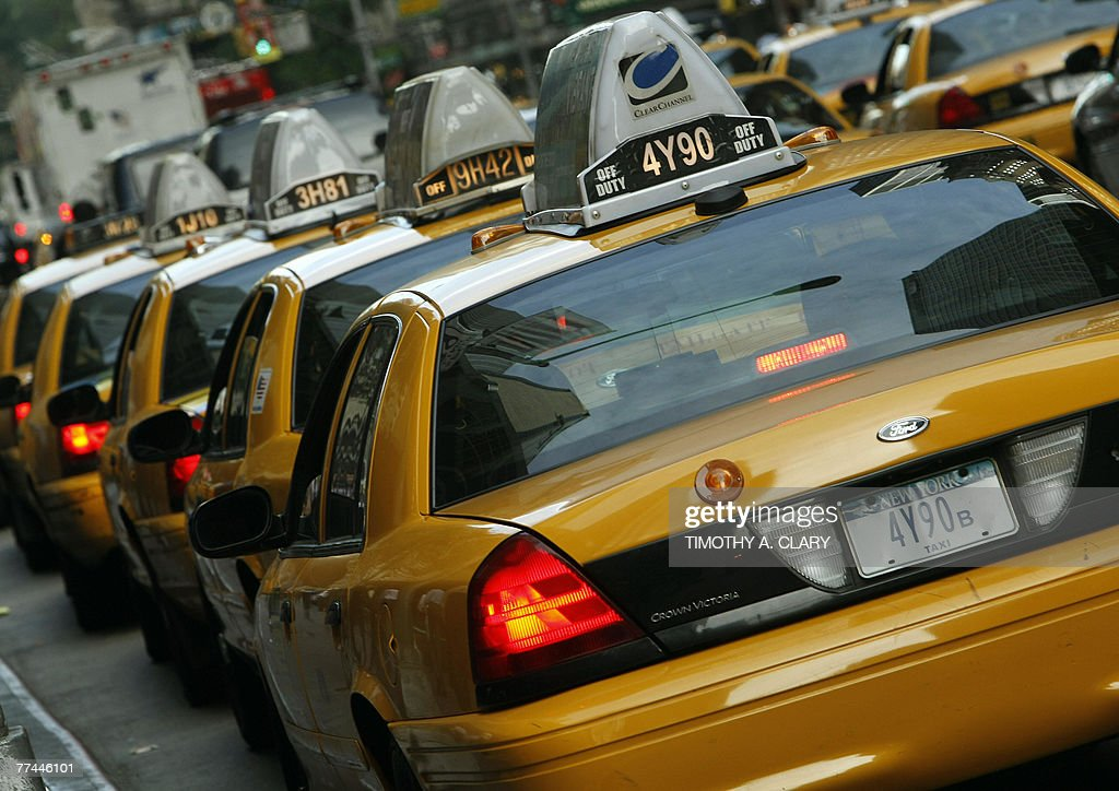 Some of the New York City cab drivers wait in line for fares on 6th Avenue 22 October 2007. City cabbies went on strike today to protest new rules requiring installation of the new devices that would let passengers watch TV, pay with credit cards and check their location on GPS.