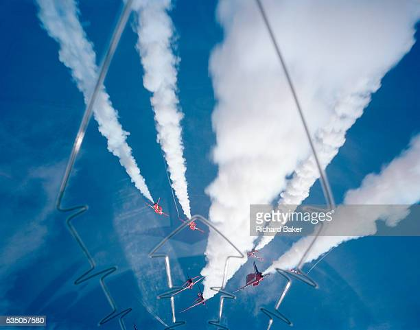 Some of the nine Hawk jet aircraft of the elite 'Red Arrows' Britain's prestigious Royal Air Force aerobatic team perform the 5/4 Split high during...