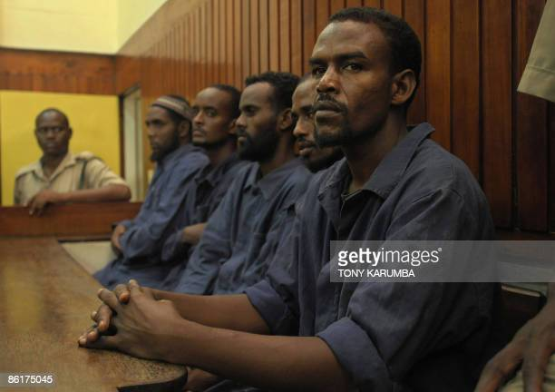 Some of the nine Somali pirates sit in a Mombasa court on April 23 2009 during their trial for the attempted hijacking of a Germanowned cargo ship in...