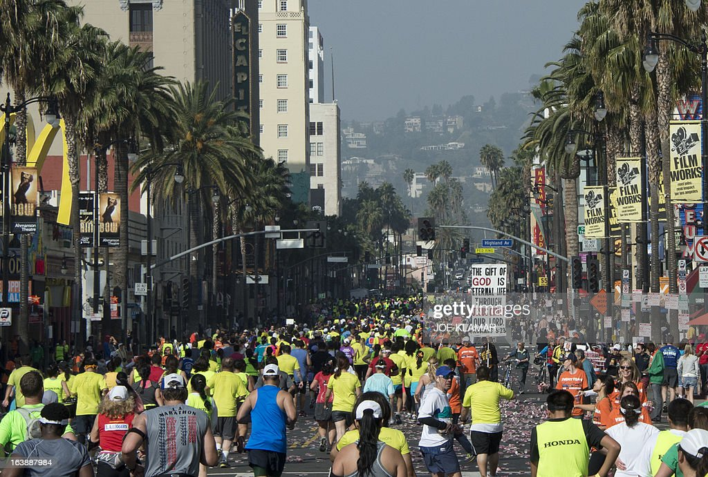 Some of the participants running down Hollywood boulevard during the annual Asics LA Marathon on March 17, 2013 in Hollywood , California. The marathon, attended by over 24 thousand participants, started at Dodger's stadium in Los Angeles and finished in Santa Monica pier.