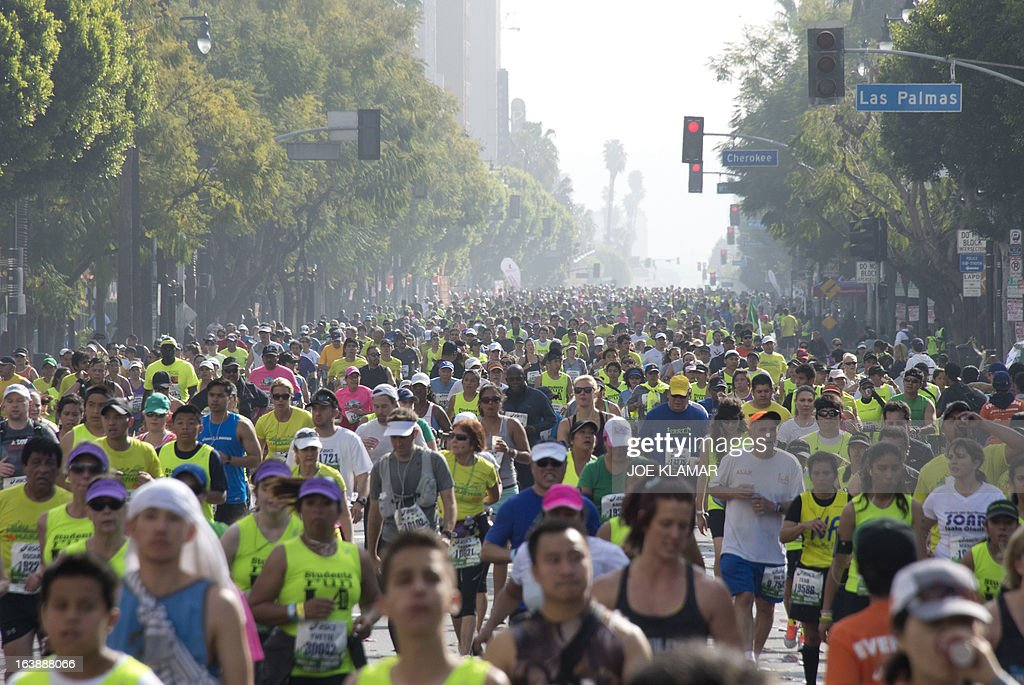 Some of the participants running down Hollywood boulevard during the annual Asics LA Marathon on March 17, 2013 in Hollywood , California. The marathon, attended by over 24 thousand participants, started at Dodger's stadium in Los Angeles and finished in Santa Monica pier. AFP/JOE KLAMAR