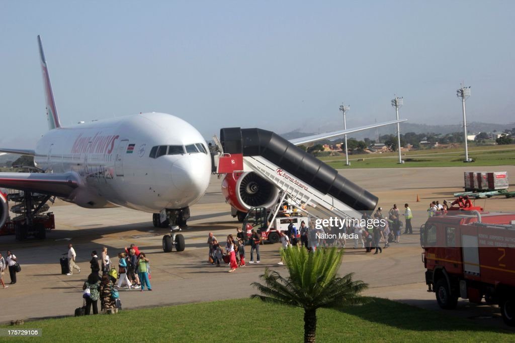 (Not for sale to The Star (Kenya), Capital FM, The People, Citizen TV, Kenya Broadcasting Corporation) Some of the passengers on Kenya airways who were diverted to Moi International Airport on August 07, 2013 in Nairobi, Kenya. Passengers were unable to leave after JKIA was closed indefinitely after fire gutted part of the international arrivals lobby.