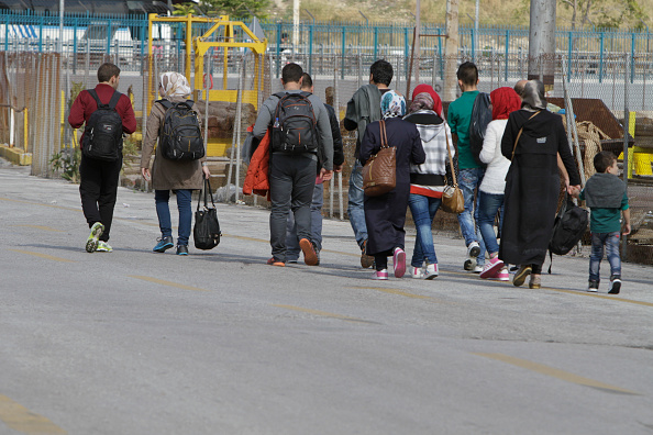 Some of the refugees make their way on foot to the metro...