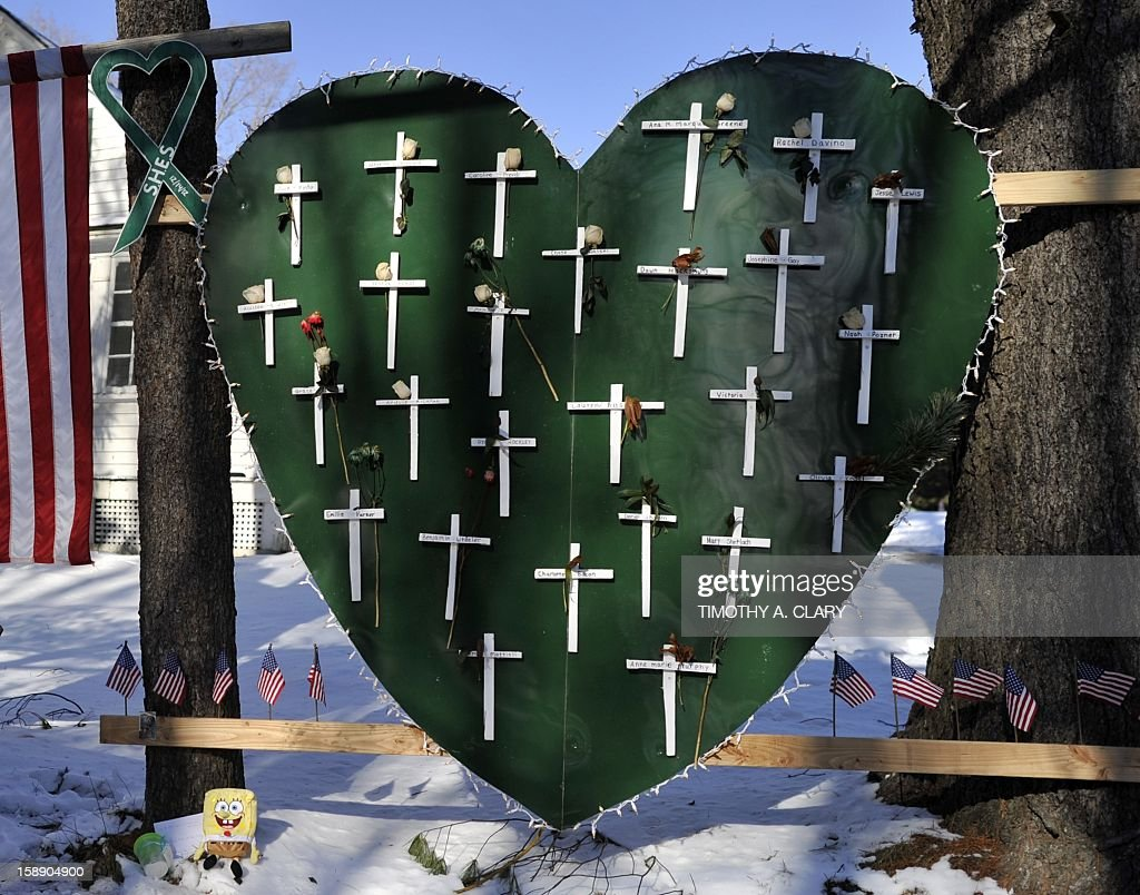 Some of the remaining memorial items to Sandy Hook Elementry students and staff who died are viewed in Newtown, Connecticut on January 3, 2013. Students at the elementary school where a gunman massacred 26 children and teachers last month were returning Thursday to classes at an alternative campus described by police as 'the safest school in America.' Survivors were finally to start their new academic year in the nearby town of Monroe, where a disused middle school has been converted and renamed from its original Chalk Hill to Sandy Hook. AFP PHOTO / TIMOTHY A. CLARY