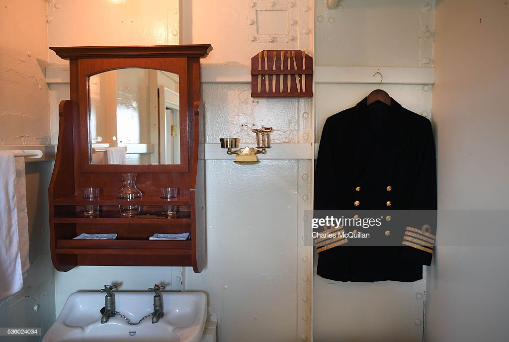 Some of the restored aspects and displays including the captain's jacket seen here in his personal quarters onboard HMS Caroline can be viewed on May 31, 2016 in Belfast, Northern Ireland. HMS Caroline is the last surviving ship from the 1916 Battle of Jutland and today hosted a special all island commemoration service ahead of it's reopening to the public tomorrow after a major restoration project. The Battle of Jutland is remembered as the largest and deadliest naval battle of World War One, where more than 6,000 British and more than 2,500 German personnel lost their lives in the 36-hour Battle off the coast of Denmark.