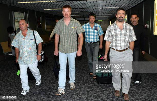 Some of the six oil workers kidnapped in Nigeria John Stewart Phil Morris Ian Metcalf Peter Vermenlin and an unnamed man arrive back at Heathrow...