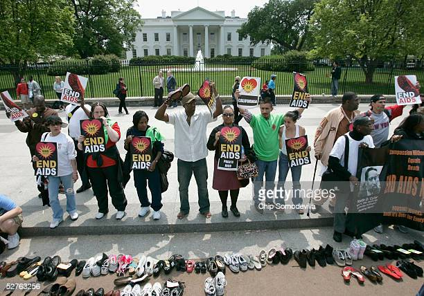 Some of the thousands of people who live with HIV/AIDS and their defenders from across the nation line up in front of the White House during the...