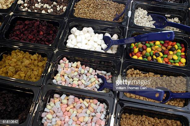 Some of the various toppings available for cereal lie in trays at Cereality Cereal Bar and Cafe December 1 2004 in Philadelphia Pennsylvania...
