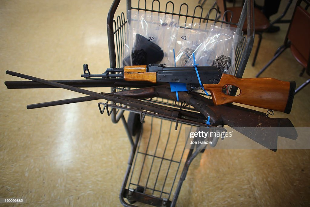 Some of the weapons turned in to the City of Miami police are seen during a gun buy back event on January 26, 2013 in Miami, Florida. The event was the second one of the year in efforts to reduce gun violence, the first one brought in 130 guns.
