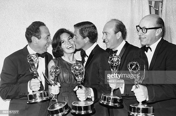 Some of the winners at the Emmy Awards holding their statuettes unknown Mary Tyler Moore Dick Van Dyke Carl Reiner and Richard Deacon Los Angeles CA...