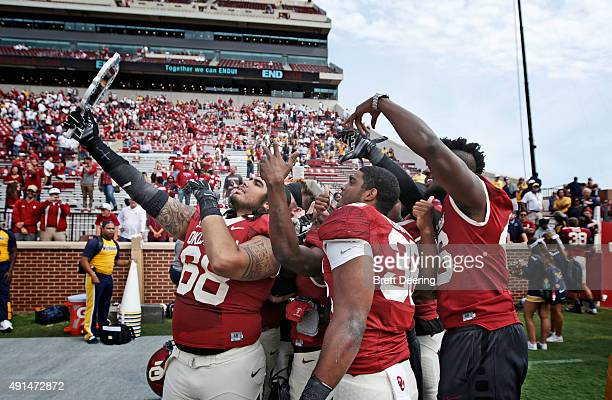 Some Oklahoma Sooners take 'selfies' after the game against the West Virginia Mountaineers October 3 2015 at Gaylord FamilyOklahoma Memorial Stadium...