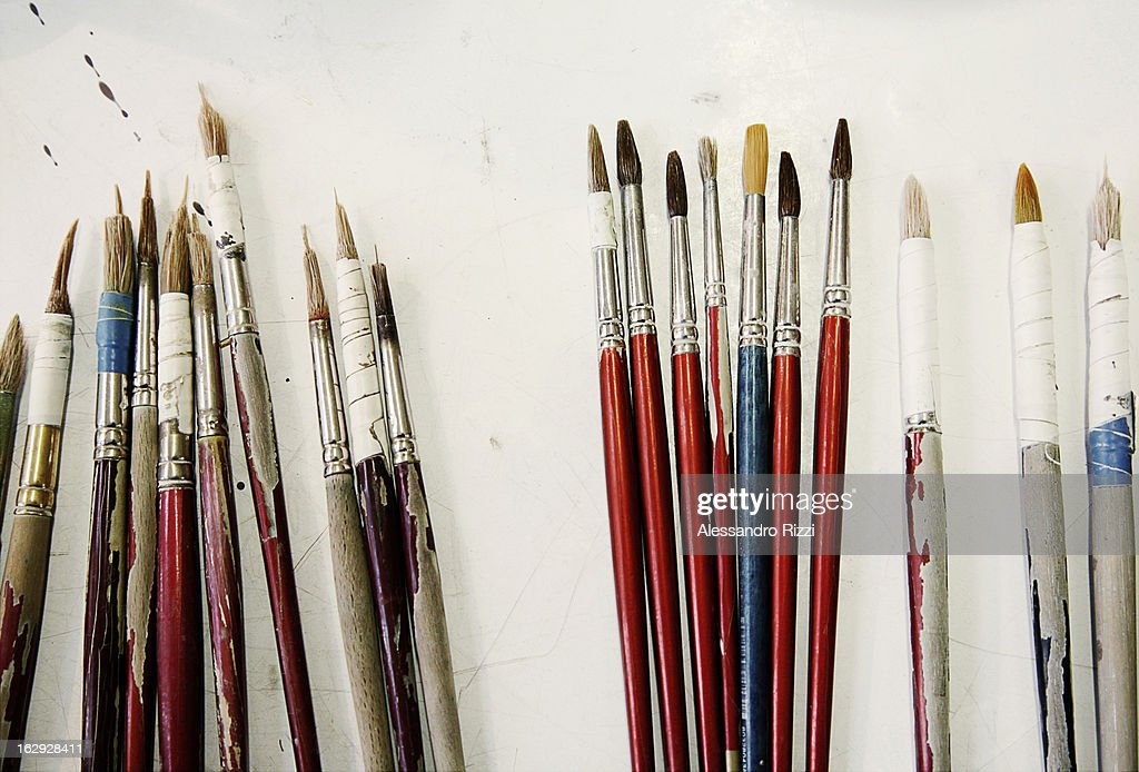 Some paint-brushes on the table : Stock Photo