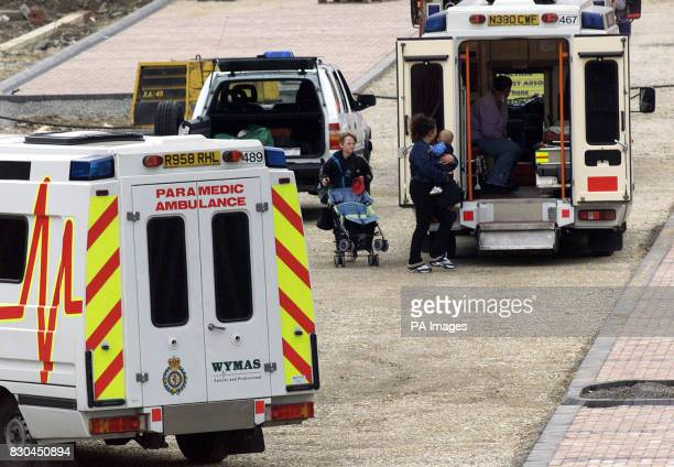 Some passengers make their way to a waiting ambulance after they were evacuated from a train following a fire in the middle carriage of the train at...