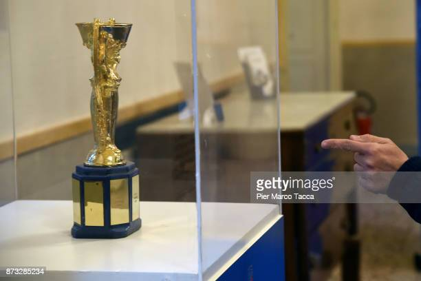 Some people are watching the Italian Football Federation Trophies displayed in Milan on November 12 2017 in Milan Italy