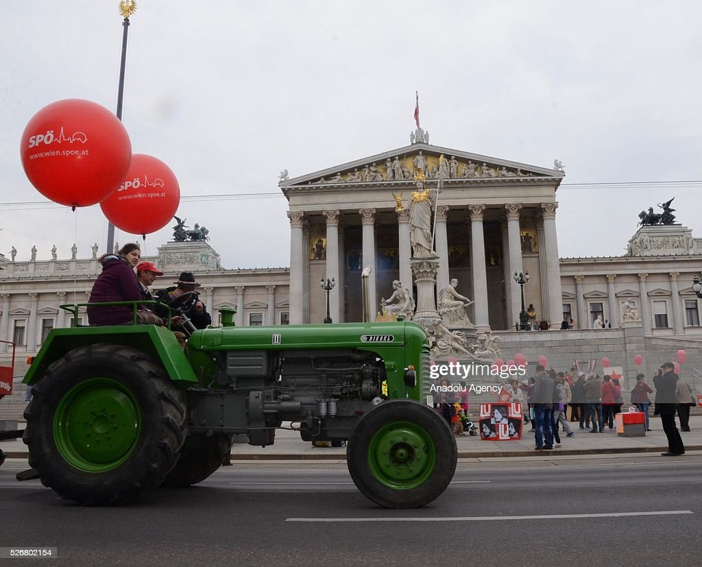 Some people attend a rally by tractor to mark May Day, International Workers' Day, in front of municipal building in Vienna, capital city of Austria on May 1, 2016.