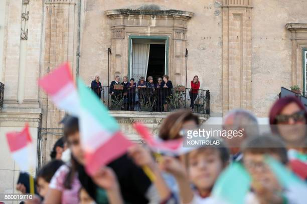 Some people celebrate in Modica Sicily southern Italy while they are waiting for Prince Albert II of Monaco