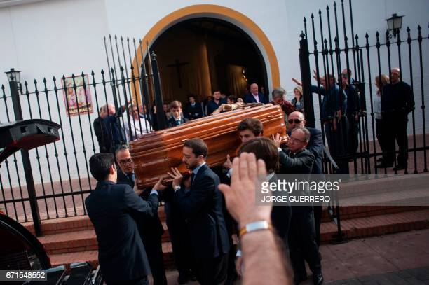 Some people do the fascist salute as relatives and friends of former Franco minister Jose Utrera Molina carry his coffin during funerals in Nerja on...