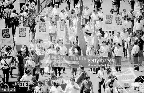 Some people showing banners and signs at the funeral of the General Secretary of the Italian Communist Party Enrico Berlinguer Rome 13th June 1984