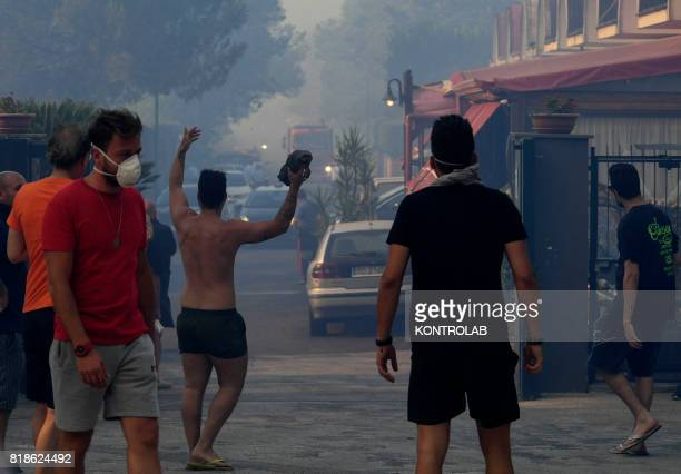 Some people tired and with masks during a vast fire that threatened the areas inhabited between Naples and Campi Flegrei throughout the day