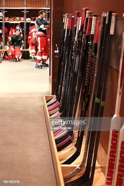 Some pink taped sticks mixed in the Detroit Red Wings locker room hall way in honor of on Breast Cancer Awareness Night before a NHL game against the...