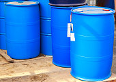 Some plastic blue barrels on a chemical plant