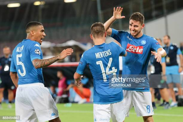 Some players of Napoli celebrate after a goal during the match between SSC Napoli and OGC Nice to qualify for the playoffs of the UEFA Champions...