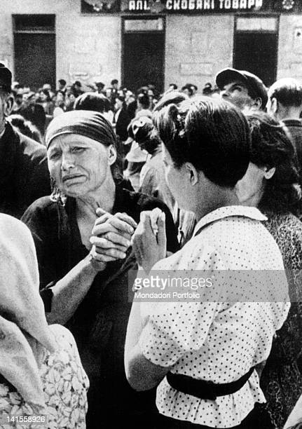 Some Polish women crying at the news that their relatives have been shot by the retiring Russian soldiers Lviv June 1941