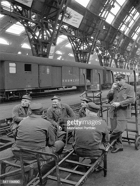 Some porters having a rest waiting for the luggage of new travellers at the Central Station Milan 1950s