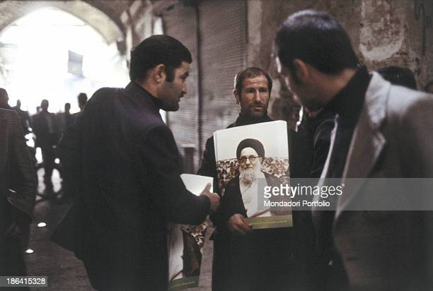 Some protesters bring the image of Ruhollah Khomeyni during the Iranian revolution The Iranian population protests during the Iranian revolution...