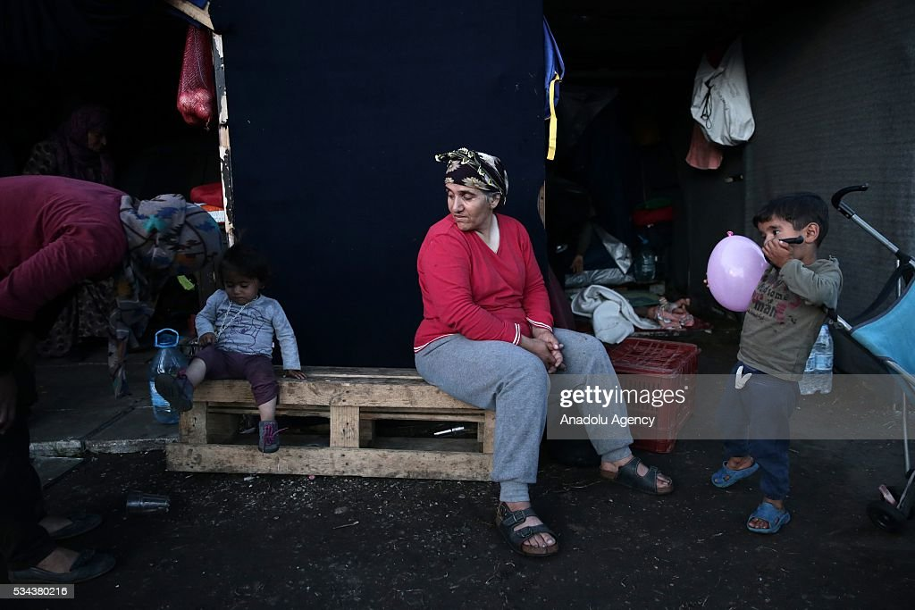 Some refugees, escaping from the evacuation in Idomeni, are seen as they wait at another refugee camp near Idomeni, Greece on May 25, 2016.